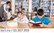 Купить «Two school children reading in school library», фото № 33307959, снято 19 декабря 2018 г. (c) Яков Филимонов / Фотобанк Лори