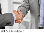 close up of businessmen making handshake at office. Стоковое фото, фотограф Syda Productions / Фотобанк Лори