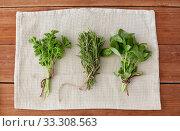 Купить «greens, spices or medicinal herbs on towel», фото № 33308563, снято 12 июля 2018 г. (c) Syda Productions / Фотобанк Лори