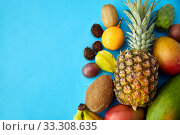 many different exotic fruits on blue background. Стоковое фото, фотограф Syda Productions / Фотобанк Лори