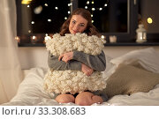 Купить «happy young woman with soft pillow in bed at home», фото № 33308683, снято 19 января 2020 г. (c) Syda Productions / Фотобанк Лори