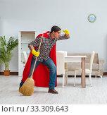 Купить «Super hero cleaner working at home», фото № 33309643, снято 22 декабря 2016 г. (c) Elnur / Фотобанк Лори