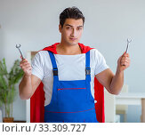 Купить «Super hero repairman working at home», фото № 33309727, снято 23 декабря 2016 г. (c) Elnur / Фотобанк Лори