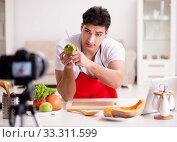 Купить «Food blogger working in the kitchen», фото № 33311599, снято 10 января 2017 г. (c) Elnur / Фотобанк Лори