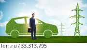 Купить «Electric car and green energy concept», фото № 33313795, снято 10 июля 2020 г. (c) Elnur / Фотобанк Лори