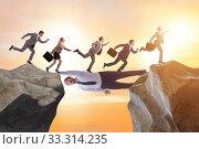 Купить «Businessman acting as a bridge in support concept», фото № 33314235, снято 6 июня 2020 г. (c) Elnur / Фотобанк Лори