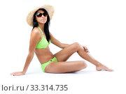 Happy young girl posing with straw hat and green bikini. Стоковое фото, фотограф Josep  M Suria / PantherMedia / Фотобанк Лори
