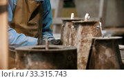 Купить «Concrete industry - man working with concrete details in the workshop - adding screws to it», видеоролик № 33315743, снято 5 июня 2020 г. (c) Константин Шишкин / Фотобанк Лори