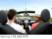 Young couple driving convertible car. Стоковое фото, фотограф Fabrice Michaudeau / PantherMedia / Фотобанк Лори