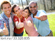 Group of students showing thumbs up. Стоковое фото, фотограф Fabrice Michaudeau / PantherMedia / Фотобанк Лори
