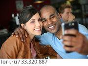 Купить «Couple of students taking picture with smarpthone», фото № 33320887, снято 30 мая 2020 г. (c) PantherMedia / Фотобанк Лори