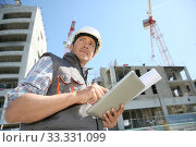Купить «Entrepreneur on building site using tablet», фото № 33331099, снято 28 марта 2020 г. (c) PantherMedia / Фотобанк Лори