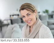 Купить «Portrait of middle-aged blond woman at home», фото № 33333055, снято 10 июля 2020 г. (c) PantherMedia / Фотобанк Лори