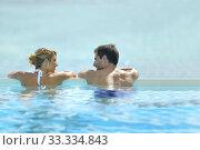 Купить «Couple swimming in infinity pool», фото № 33334843, снято 8 апреля 2020 г. (c) PantherMedia / Фотобанк Лори