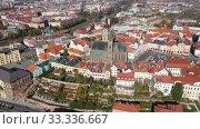 Купить «Panoramic aerial view of autumn Hradec Kralove townscape with Renaissance clock tower and Gothic Cathedral on sunny day, Czech Republic», видеоролик № 33336667, снято 18 октября 2019 г. (c) Яков Филимонов / Фотобанк Лори