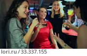 Купить «Happy positive females friends with cocktail in the club on party», видеоролик № 33337155, снято 31 марта 2020 г. (c) Яков Филимонов / Фотобанк Лори