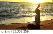 Купить «Sea yoga woman hands up in sun salute lotus position», видеоролик № 33338259, снято 25 сентября 2019 г. (c) Gennadiy Poznyakov / Фотобанк Лори