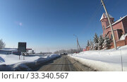 Купить «Suburb of the city of Novosibirsk in winter. Driving on a snowy Vasilkovaya street», видеоролик № 33340567, снято 21 февраля 2020 г. (c) Serg Zastavkin / Фотобанк Лори