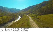 Купить «Low altitude flight over fresh fast mountain river with rocks at sunny summer morning.», видеоролик № 33340927, снято 10 апреля 2019 г. (c) Александр Маркин / Фотобанк Лори