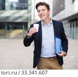 Купить «Portrait of cheerful male with documents», фото № 33341607, снято 20 апреля 2017 г. (c) Яков Филимонов / Фотобанк Лори