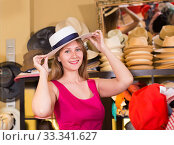 Купить «young blonde woman choose straw hat in shop», фото № 33341627, снято 2 мая 2017 г. (c) Яков Филимонов / Фотобанк Лори