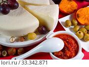 Купить «Домашний сыр сулугуни. Натюрморт с сыром, хурмой и соусом аджика. Домашнее приготовление», фото № 33342871, снято 25 февраля 2020 г. (c) ирина реброва / Фотобанк Лори