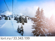 Купить «Ski lift in snow alps mountain with firs on back», фото № 33343199, снято 2 марта 2019 г. (c) Сергей Новиков / Фотобанк Лори
