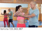 Self-defense workout with personal trainer in gym, martial art. Стоковое фото, фотограф Яков Филимонов / Фотобанк Лори