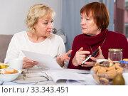 Купить «Two elderly women faced financials troubles», фото № 33343451, снято 22 ноября 2017 г. (c) Яков Филимонов / Фотобанк Лори