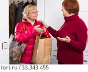 smiling mature female taking friend woman. Стоковое фото, фотограф Яков Филимонов / Фотобанк Лори