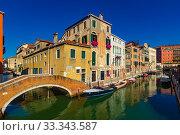 Купить «View of canals and cityscape with colorful buildings in Venice», фото № 33343587, снято 5 сентября 2019 г. (c) Яков Филимонов / Фотобанк Лори
