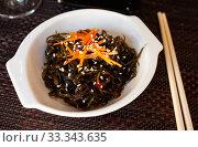 Купить «Appetizing seaweed salad. Japanese cuisine», фото № 33343635, снято 9 апреля 2020 г. (c) Яков Филимонов / Фотобанк Лори
