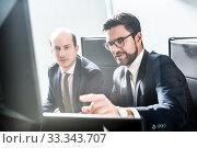 Купить «Business team analyzing data at business meeting in modern corporate office.», фото № 33343707, снято 10 января 2020 г. (c) Matej Kastelic / Фотобанк Лори