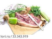 Купить «Piece of raw pork and vegetables on a white background», фото № 33343919, снято 21 февраля 2020 г. (c) Татьяна Ляпи / Фотобанк Лори