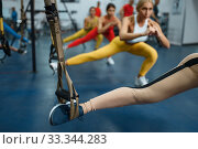 Купить «Women doing stretching exercise in gym», фото № 33344283, снято 13 декабря 2019 г. (c) Tryapitsyn Sergiy / Фотобанк Лори