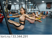 Купить «Group of women doing press exercise in gym», фото № 33344291, снято 13 декабря 2019 г. (c) Tryapitsyn Sergiy / Фотобанк Лори