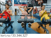 Women doing abs exercise in gym, front view. Стоковое фото, фотограф Tryapitsyn Sergiy / Фотобанк Лори