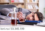 Купить «Young businessman drinking from stress», фото № 33345199, снято 16 декабря 2016 г. (c) Elnur / Фотобанк Лори