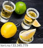 Купить «Tequila drink served in glasses with lime and salt», фото № 33345779, снято 18 сентября 2017 г. (c) Elnur / Фотобанк Лори