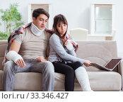 Купить «Injured family of wife and husband recovering at home», фото № 33346427, снято 9 января 2018 г. (c) Elnur / Фотобанк Лори