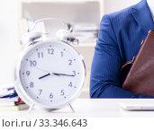 Купить «Businessman in rush trying to meet deadline», фото № 33346643, снято 2 декабря 2017 г. (c) Elnur / Фотобанк Лори