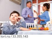 Купить «Unhappy boy with quarreling parents», фото № 33355143, снято 5 июня 2020 г. (c) Яков Филимонов / Фотобанк Лори