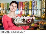 Купить «Photo of girl in the shop with lots of sweets», фото № 33355207, снято 22 марта 2017 г. (c) Яков Филимонов / Фотобанк Лори