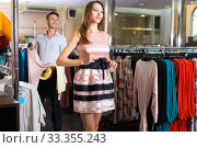 Young cheerful person is trying on new pink dress. Стоковое фото, фотограф Яков Филимонов / Фотобанк Лори