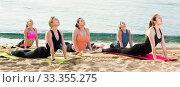 Купить «Group of young females performing yoga», фото № 33355275, снято 22 мая 2017 г. (c) Яков Филимонов / Фотобанк Лори