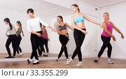 Купить «Ordinary active females exercising dance moves», фото № 33355299, снято 21 сентября 2019 г. (c) Яков Филимонов / Фотобанк Лори