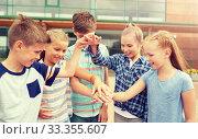Купить «group of happy elementary school students», фото № 33355607, снято 24 июля 2016 г. (c) Syda Productions / Фотобанк Лори