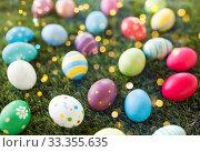 Купить «colored easter eggs on artificial grass», фото № 33355635, снято 15 марта 2018 г. (c) Syda Productions / Фотобанк Лори