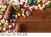 Купить «chocolate eggs, easter bunny and candies on wood», фото № 33355639, снято 22 марта 2018 г. (c) Syda Productions / Фотобанк Лори