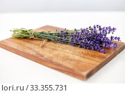 Купить «bunch of lavender flowers on wooden board», фото № 33355731, снято 12 июля 2018 г. (c) Syda Productions / Фотобанк Лори